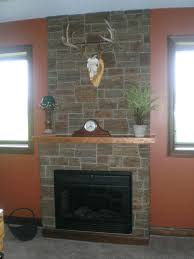 fireplace stacked stone panels lime modern tile over