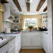 Kitchen Cabinets Cottage Style by Wooden Vaulted Ceiling For Classic White Cabinet For Small Cottage