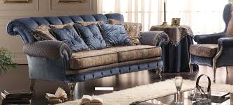 interactive blue velvet sofa and black wooden coffee table also