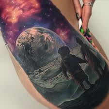 boy and on moon by rix tattoos
