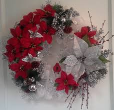 geo mesh white geo mesh wreath decorated with small poinsettias and one
