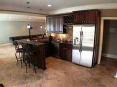 small basement kitchen ideas basement bar with granite countertops and stainless steel