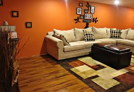 bright orange basement wall paint combined with light brown