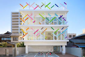 colorful building colorful branches cover this new kindergarten building in japan