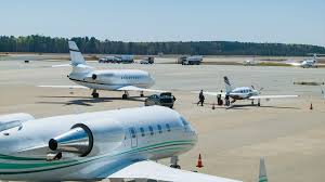 North Carolina travel air images People boarding private airplane at raleigh durham international png