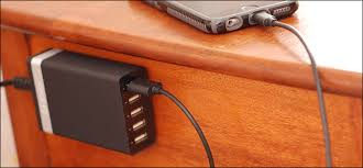 how to add a charging station to your nightstand without ruining it