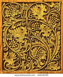 wood carving grapevine pattern stock photo royalty free