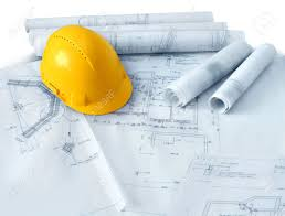 construction plans construction plans drawings rolls and yellow hat helmet stock