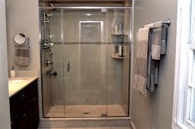 grand half bathroom designs with single glass shower door added