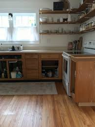 removing laminate from kitchen cabinets and painting our painted kitchen cabinets the by home