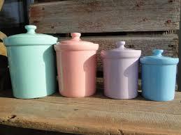 reserved for lauren set of four vintage pastel ceramic canisters