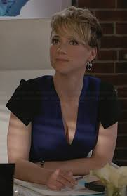 hairstyles of margaux on revenge margaux s blue v neck dress with black shoulders on revenge