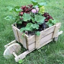 Wooden Wheelbarrow Planter by 9 Diy Garden Planter Projects Diy To Make
