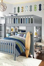 blue wooden loft bed with wardrobe and stair also desk teenage