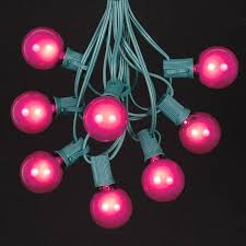 pink g40 globe outdoor string light set on green wire