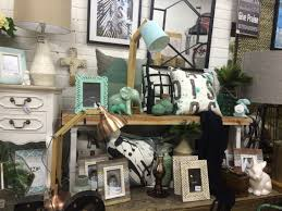 mustard and indigo shop display home decor and interiors at mint and black shop display visual merchandising at lavish abode home and interior decor shop