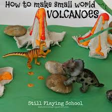 dinosaur small world with homemade volcanoes still playing