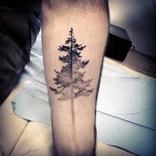 black and grey tree on forearm tattoos and piercings