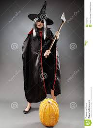 sorcerer with axe and pumpkin stock photo image 44016704
