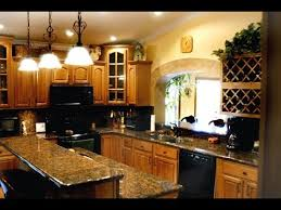 what color granite goes with golden oak cabinets honey oak kitchen cabinets with granite countertops