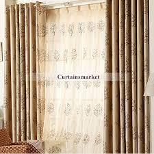 long window curtains are decorated with tree patterns