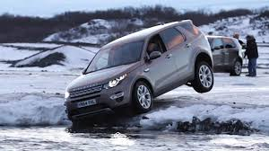 blue land rover discovery icy adventure in the land rover discovery sport