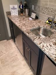 bianco antico polished granite counter with dark espresso cabinets
