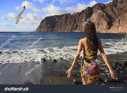 beautiful brunette standing on beach stock photo 438245866