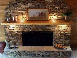 charming stone wall fireplace on interior with north star