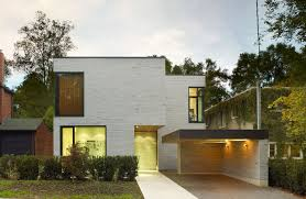 cedarvale ravine house designed by drew mandel architects architecture front yard small modern house design with white brick wall exterior color and garage