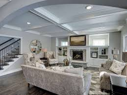 traditional living room with high ceiling u0026 hardwood floors in