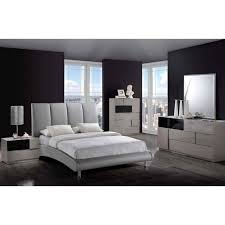 ultra modern grey upholstered bed with glossy grey case goods