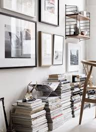 nordic home et cetera magazines and books piled up