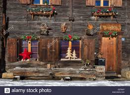 decorations decorating swiss wooden chalet in the alps