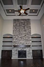 2 story great room coffered ceiling stone fireplace interior