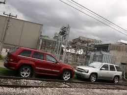 stanced jeep srt8 2006 chevrolet trailblazer ss vs 2006 jeep grand cherokee srt8