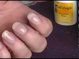 acrylic powder dip using glue for adding strength to nails nail
