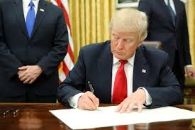 trump oval office pictures trump signs executive order on obamacare on inauguration day nbc