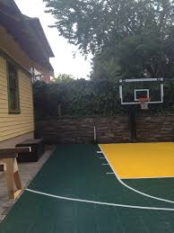 this pro dunk platinum goal stands tall over a green and gold half