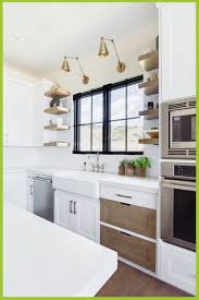 kitchen ideas with white cabinets and stainless steel appliances kitchen by maloney interior design bowdeco co