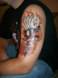 flaming skull and dice on left sleeve photos pictures