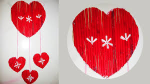 wall hanging ideas with waste material heart shaped newspaper
