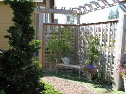 put lattice on diagonal in corner by barn and west side a garden