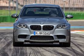 lexus vs bmw cost super sedan showdown 2016 cts v vs charger hellcat vs m5 vs