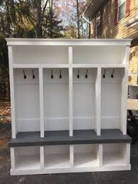 large white wooden mud room lockers with storage bench with