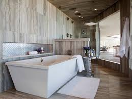 Contemporary Bathroom Lighting Ideas by Bathroom White Tile Freestanding Bathtub Brown Hardwood Flooring
