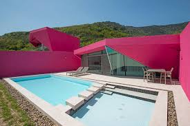single level homes pink pool villas burst onto mountain scene curbed