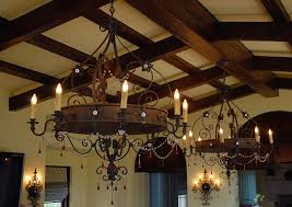 Dining Room Chandeliers Rustic Rustic Dining Room With Large Wrought Iron Chandelier Over Round