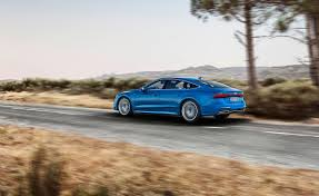 2019 audi a7 sportback rear left driving photos first pictures