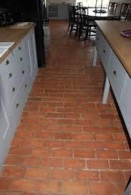 terra cotta ceramic floor tile and reclaimed quarry tiles